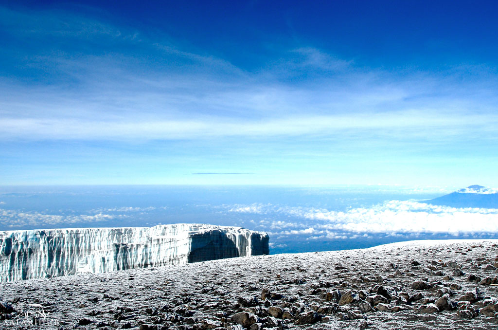 School Huts (4,750m/15,600ft) to Uhuru Peak (5,895m/19,340ft) to Mweka Camp (3,110m/10,200ft)
